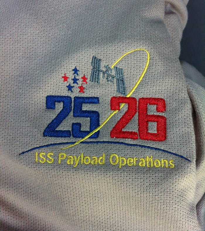ISS Increment 25/26 Payload Operations Integration Center's mission shirt.