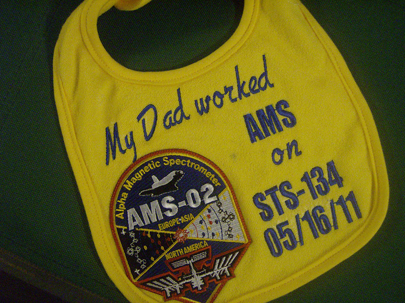 Personalized baby bib for an aerospace engineer's little one.