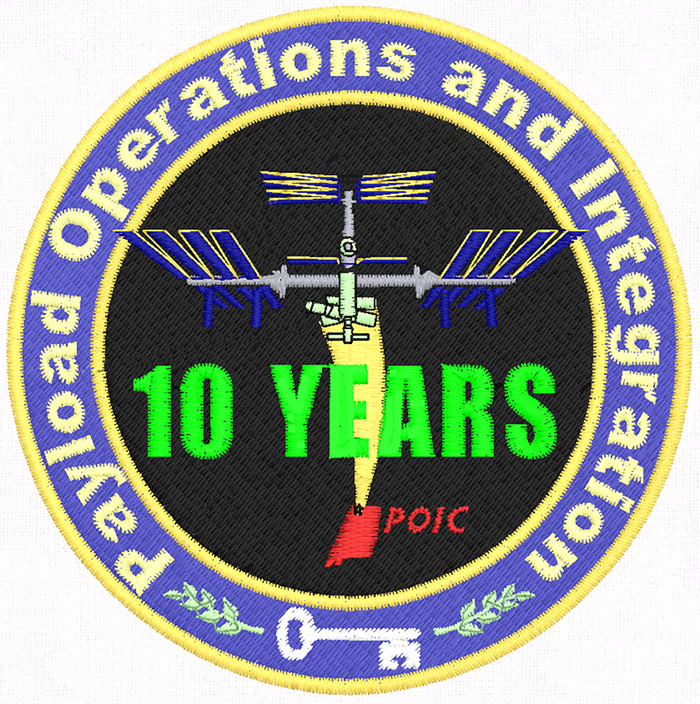 The design, marking the 10-year anniversary  of the Payload Operations and Integration Center, was digitized and stitched by Threadbearer.