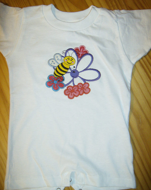 Example of applique stitching on a baby's creeper.