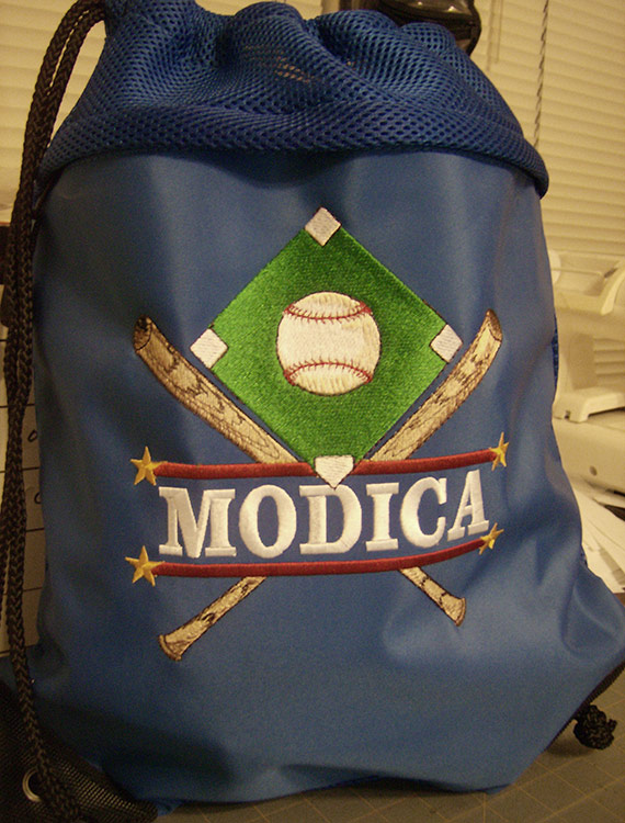 Some designs have an area for personalization, such as the design depicted on this Drawstring back pack.  Design is ~15 x 15 inches embroidered on the front pocket of a back pack to help the players keep their gear straight.
